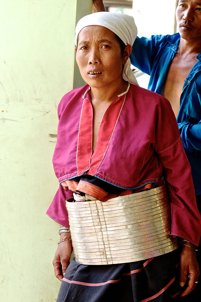 The women of the   Jzin-uh  Palaung are distinguishable by their thick silver-plated belts and white headscarves. Though all Palaung live high up in the Shan mountains, each of the tribes has a distinct dialect and traditional form of dress.