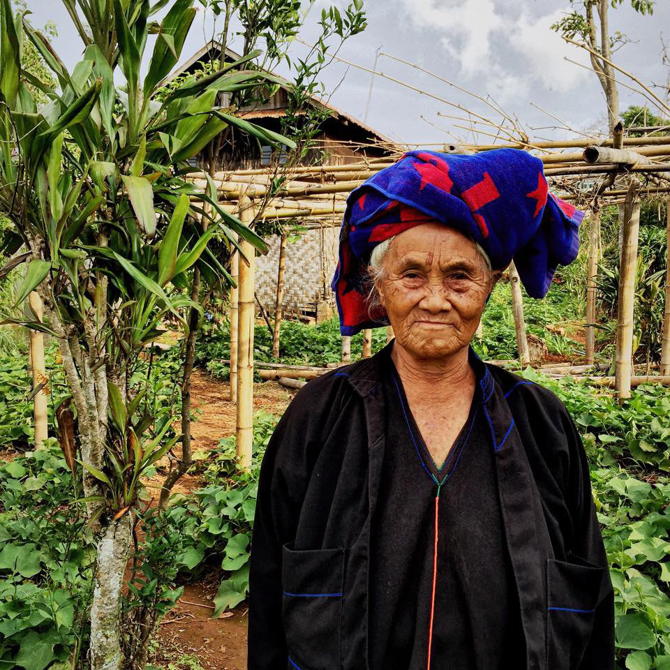 Nang Pwan, Nang meaning 'Miss' in Pa-O, stands in the same family garden she has tended for over seventy years.