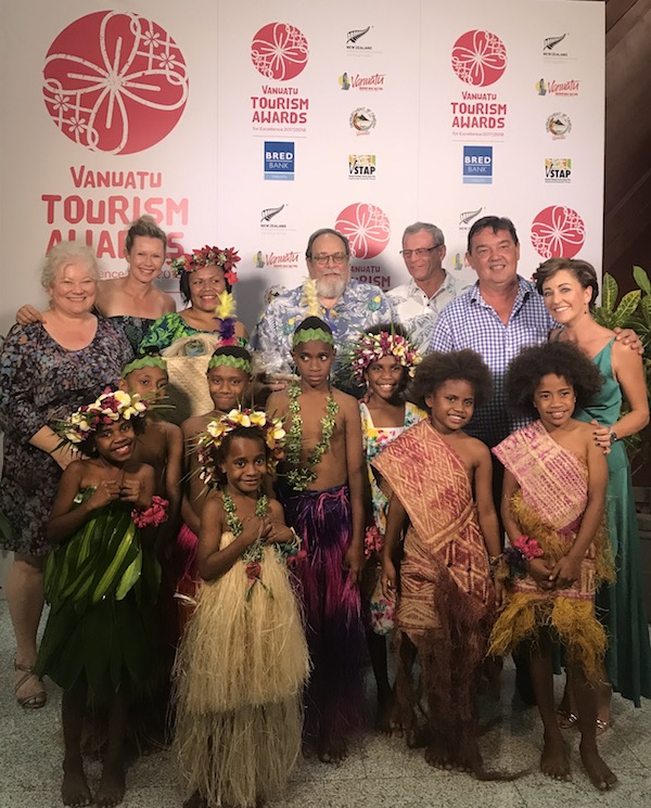 The Ni-Vanuatu piccaninnies present the judges with thank you gifts made from all local resources
