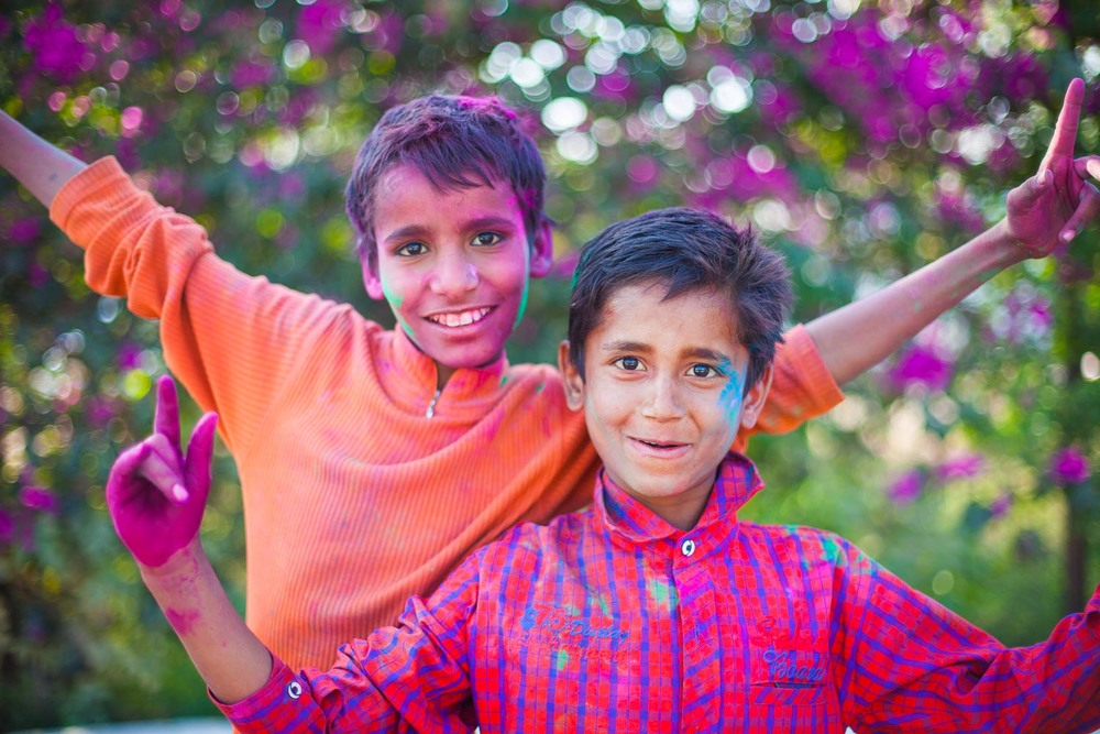 Two boys can hardly wait to play Holi, so they start a day early: Jaipur, Rajasthan