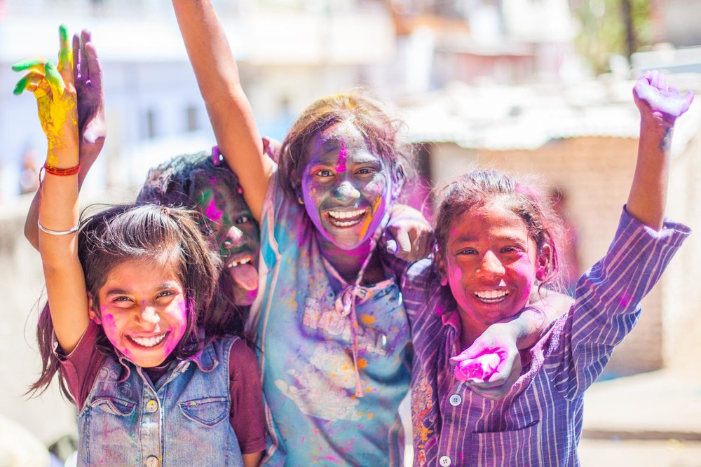 Happy Holi! A group of girls partake in the merriment of the festival: Jaipur, Rajasthan
