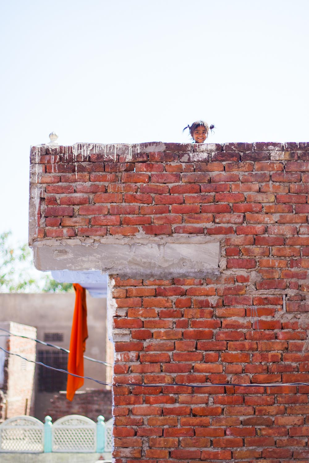 A little girl on her family's roof top during the Holi festival: Jaipur, India