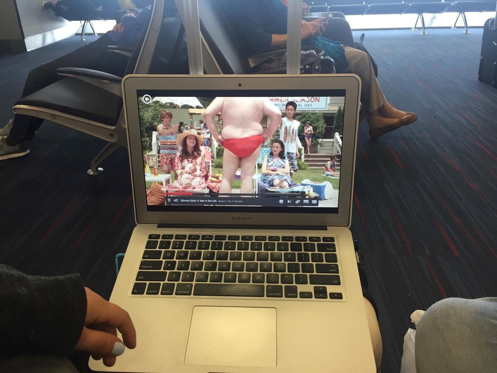 Waiting out our flight delay with an episode of Gilmore Girls.