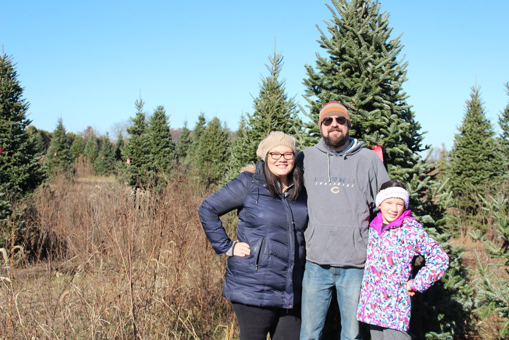 Cutting down a Christmas tree becomes a family memory to treasure at farms such as Henslers Nursery in Indiana.