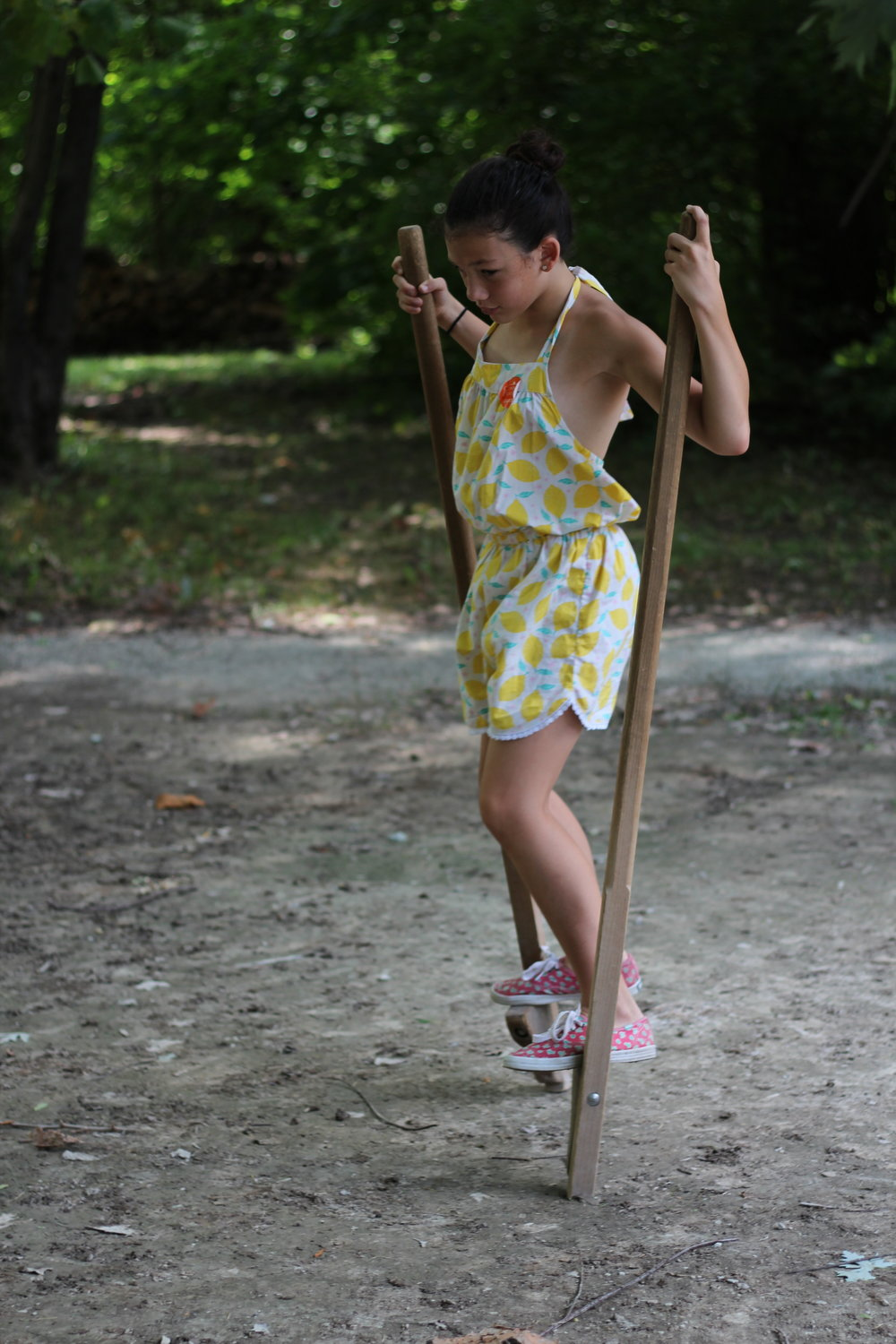 Stilts on stilts, well maybe she's not that tall, enjoying one of the many fun games and activities at Conner Prairie, Fishers Indiana