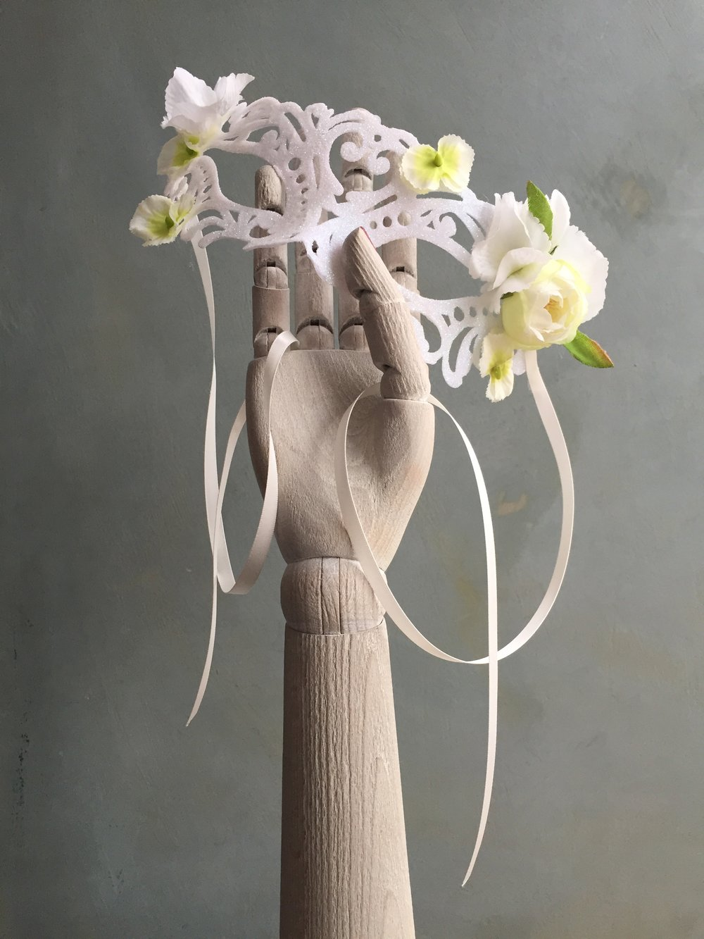 Mask with white flowers