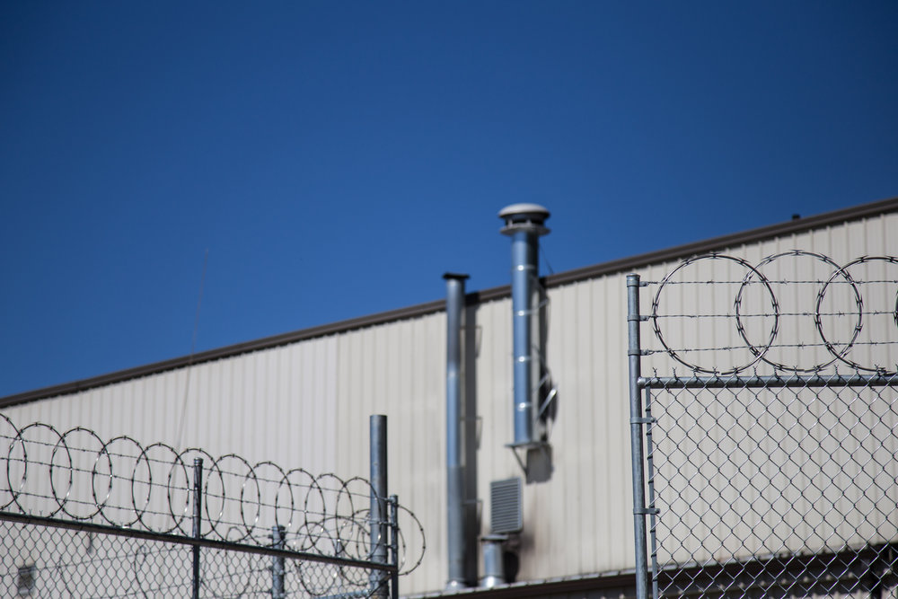 Barbed-wire encloses the minimum security facility.