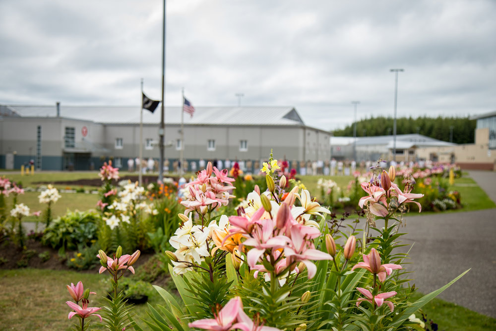 The morning lineup at Stafford Creek Corrections Center takes place among flower gardens full of lilies.