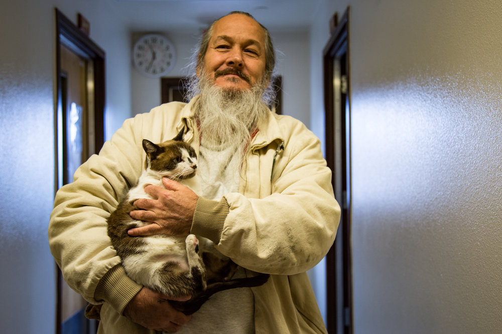 Leo Fannin proudly shows off the cat he is rehabilitating in the Larch Cat Adoption Program which works with the West Columbia Gorge Humane Society and the Humane Society of Southwest WA.