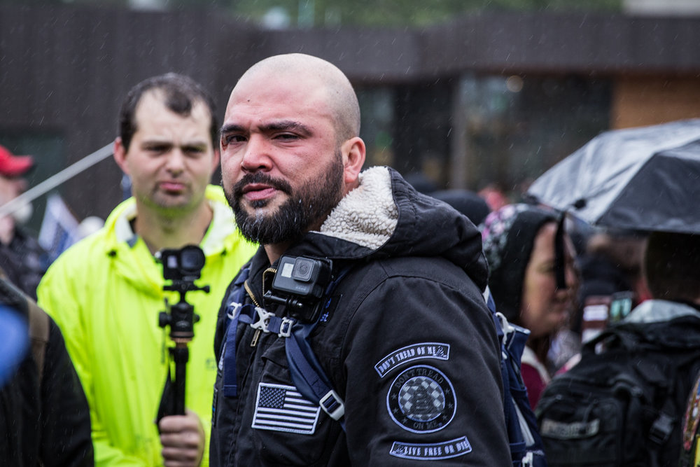 Joey Gibson of Patriot Prayer recovering from an unknown irritant being sprayed in his eyes.