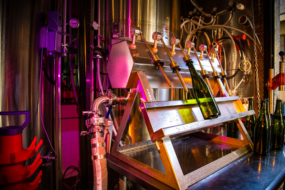 Three Magnets uses their new 6-head bottle filler. Made in Italy, it's geared towards wine filling and/or packaging flat products. In the case of Three Magnets, they bottle condition which is a secondary refermentation using champagne yeast and sugars in order to create carbonation within the bottle. This process takes about a month.