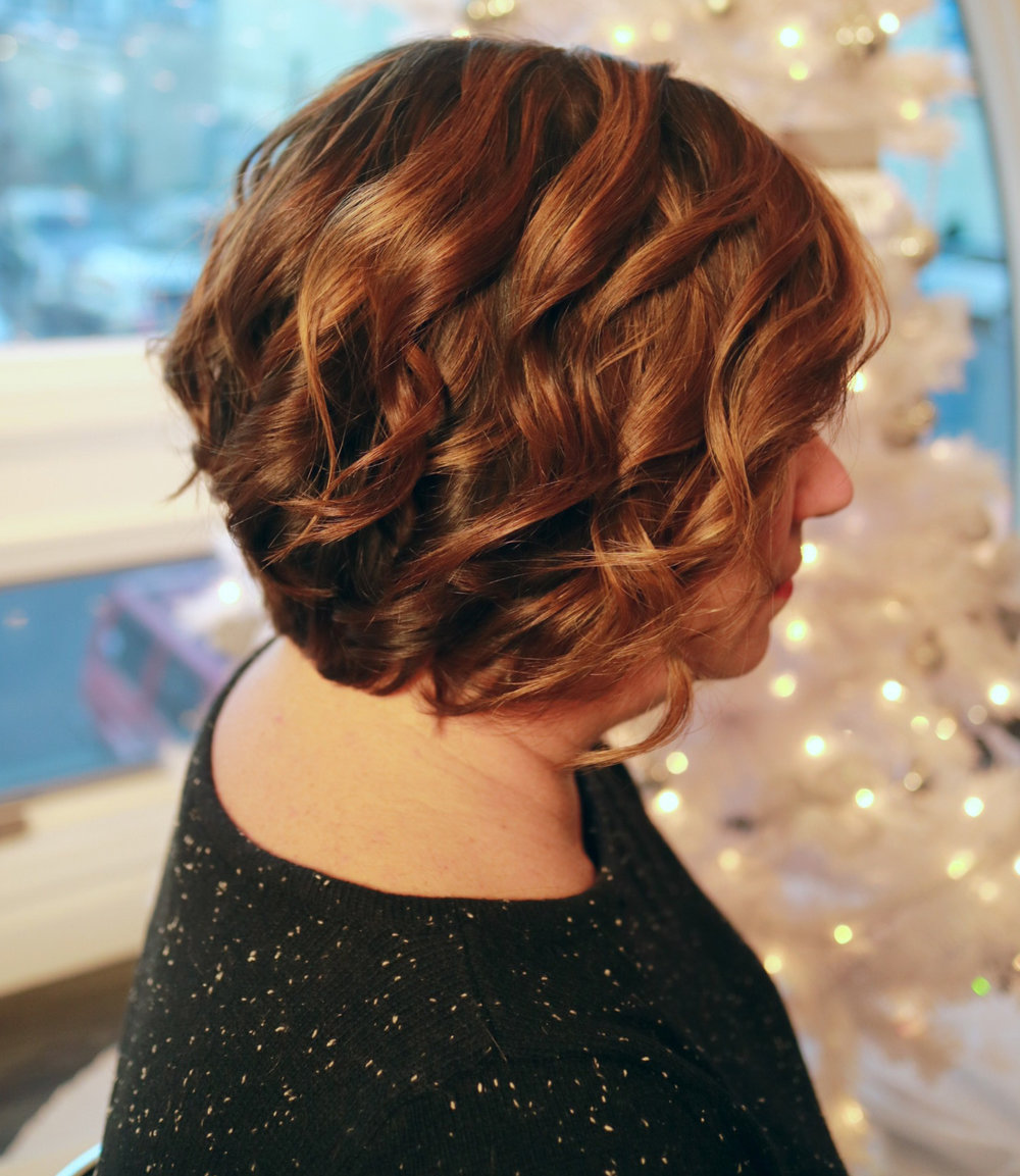 These Christmas curls are glistening with Kevin.Murphy Shine.Spray | Styled by Baby Kate
