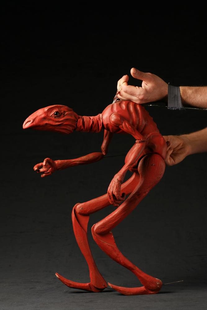 Luc Favre, devil lizard puppet. Photo by Ashleigh Kennedy.