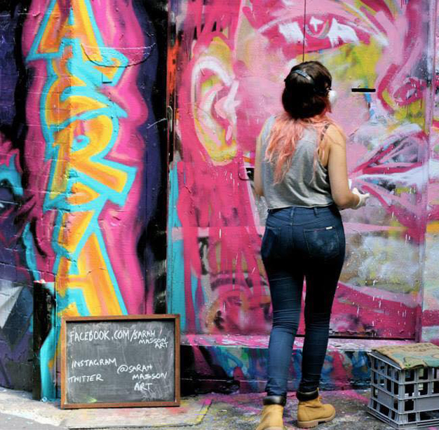 Sarah painting in Hosier Lane. Photo by Emily Dalkin.