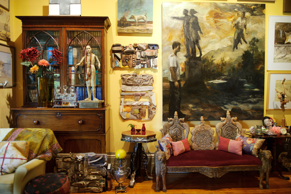 The front room of Julian's house, with some of his work on the wall.