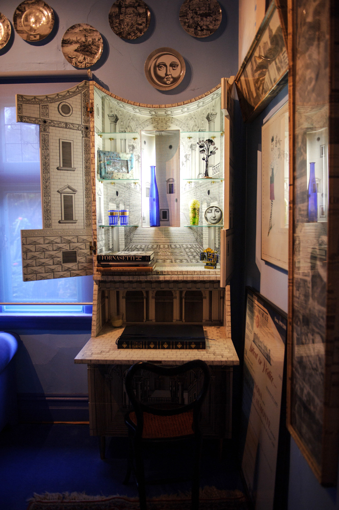 Cabinet by Italian painter, sculptor and engraver Piero Fornasetti, in Julian's house.