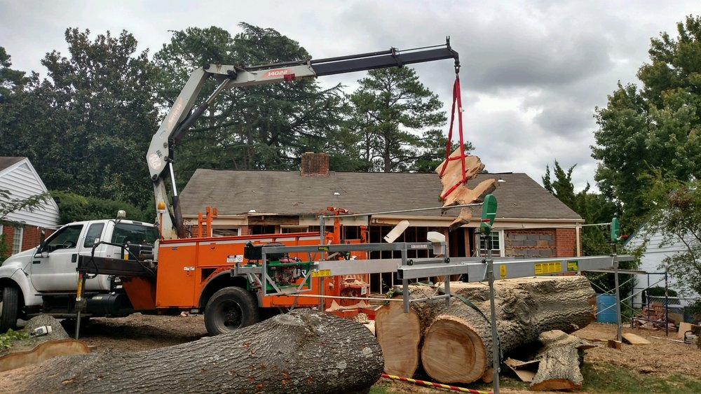 Using the crane to pull each slab off the log
