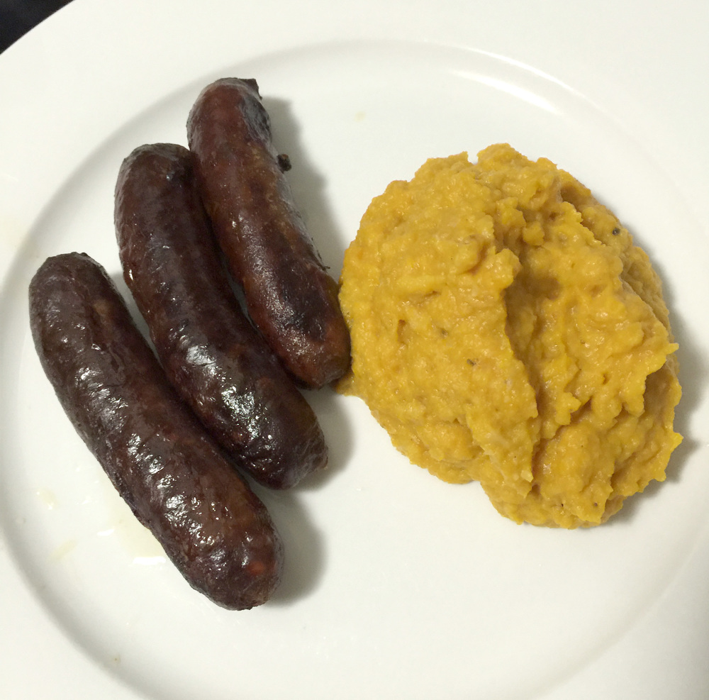Perfect LCHF Cauliflower and Roast Pumpkin Mash on the side of some paleo snags.