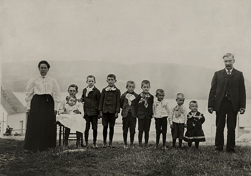 An informal group portrait of a family with nine sons in Nova Scotia