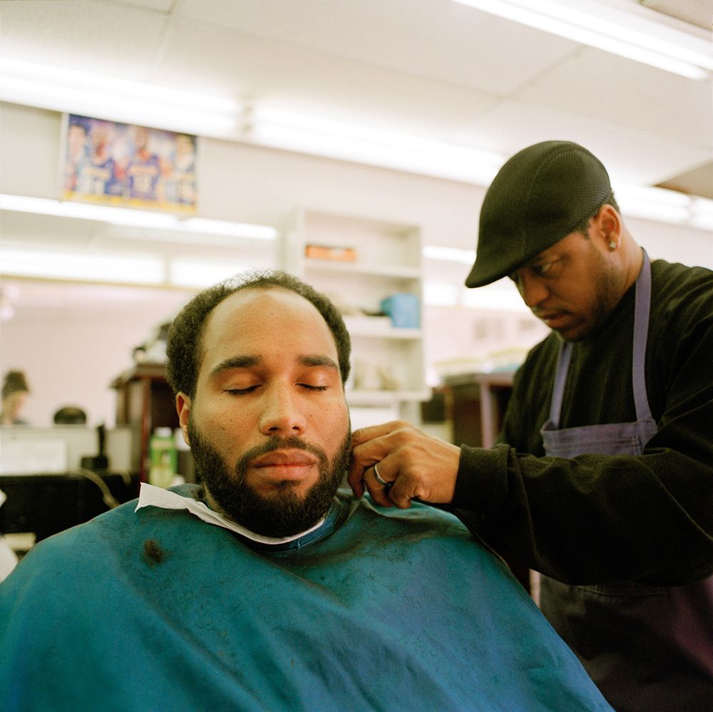 Isaac used to cut hair in the neighborhood, then he opened up his own shop, Los Angeles  2013