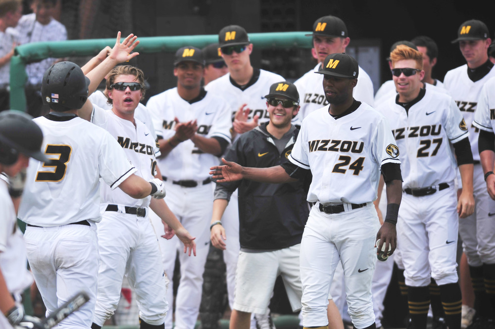 The rest of the team congratulates Shane Benes after his homerun at Taylor Stadium in Columbia, Mo. on May 3, 2015. Benes was the only Tiger to hit a homerun during the game.
