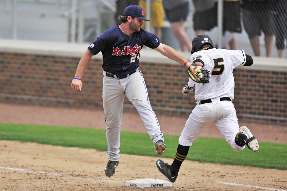Missouri's Brett Bond reaches first base before Mississippi's Sikes Orvis can apply the tag during the Tigers' 4-3 loss on Sunday on Simmons Field. Bond went 2 for 4 with two RBI for Tigers.