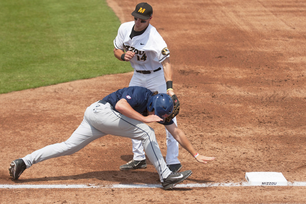 Missouri's Zach Lavy tags Ole Miss' Nic Perkins at first base at Taylor Stadium in Columbia, Mo. on May 3, 2015. The Tigers lost 4-3.