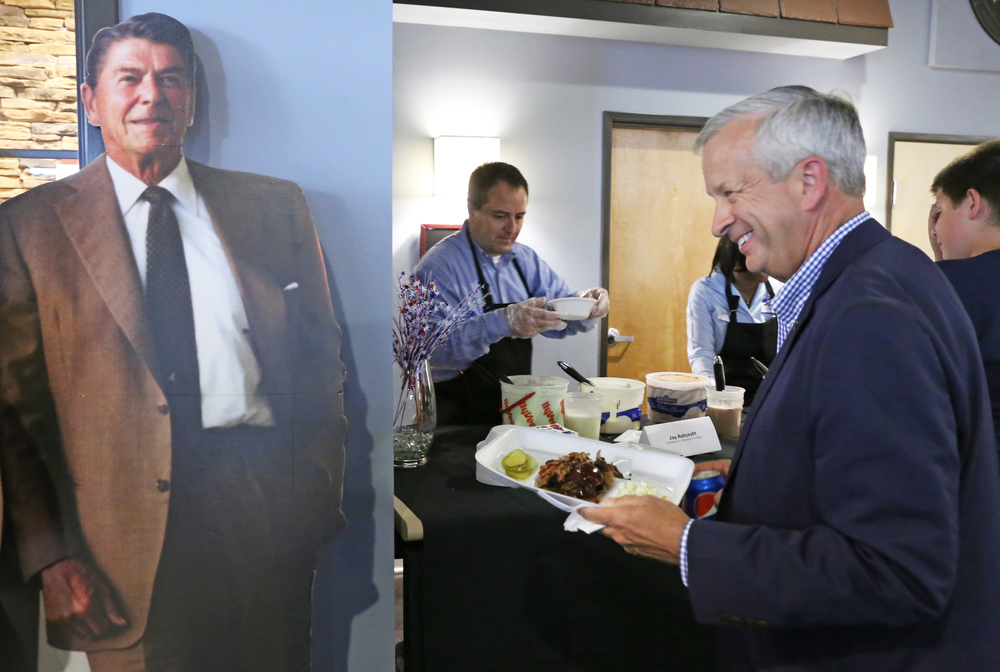 Missouri gubernatorial candidate John Brunner smiles Sunday as he walks by a Ronald Reagan cutout at the Boone County Republicans' annual ice cream social. The event is held on National Ice Cream Day, which Reagan established when he was president.