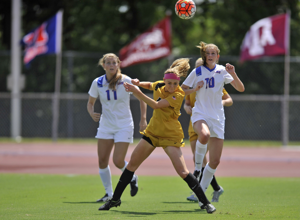 Missouri's Lauren Flynn, center, and SMU's Haley Thompson, left, and Blair Thorpe battle for the ball during a 1-1 tie Sunday at Walton Stadium.