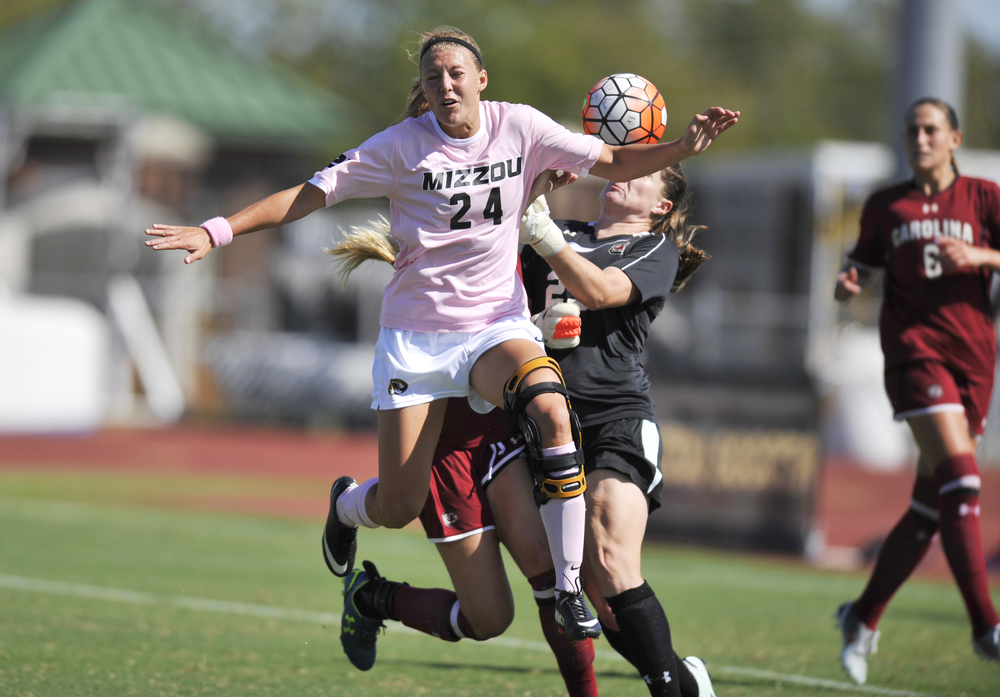 Missouri's Jessica Herrman leaps for the ball in front of South Carolina's Paige Bendell and Caroline Kelly at Walton Stadium in Columbia, Mo. on Sunday, September 20, 2015. Missouri lost 1-0.
