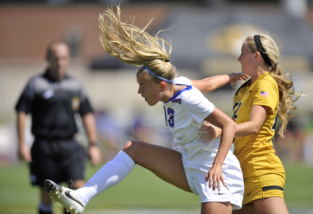 SMU's Paige Jacobs and Missouri's Macee Blanchard land after jumping for the ball at Walton Stadium in Columbia, Mo. on Sunday, August 23, 2015. The game ended in a tie after double overtime.