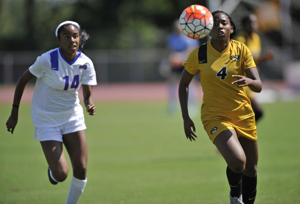 SMU's Chinelo Odobulu and Missouri's Erin Webb both go for the ball at Walton Stadium in Columbia, Mo. on Sunday, August 23, 2015. The game ended in a tie after double overtime.