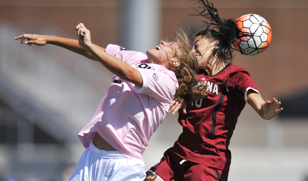 Missouri's Lauren Selaiden and South Carolina's Stevi Parker both jump to head-butt the ball at Walton Stadium in Columbia, Mo. on Sunday, September 20, 2015. Missouri lost 1-0.