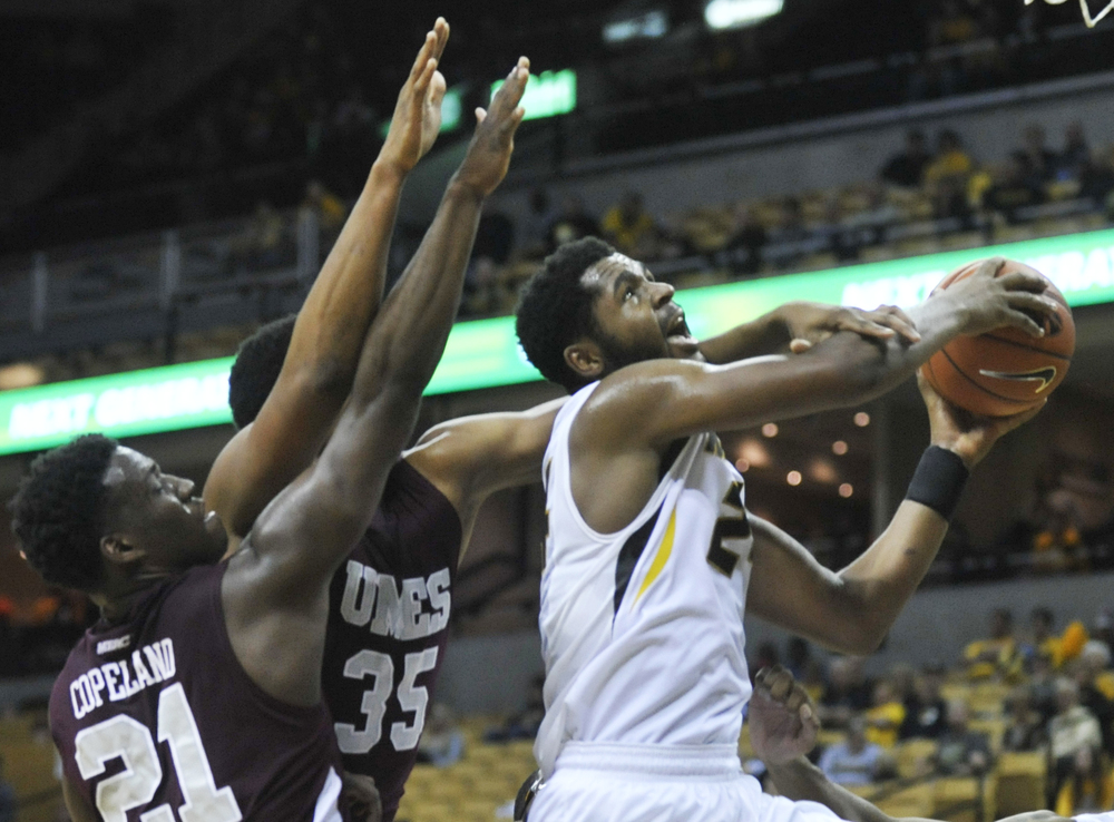 Missouri's Kevin Puryear shoots the ball as Maryland-Eastern Shore's Bakari Copeland and Isaac Taylor attempt to block him during their game on Sunday, November 15, 2015 at Mizzou Arena. Missouri won 73-55.