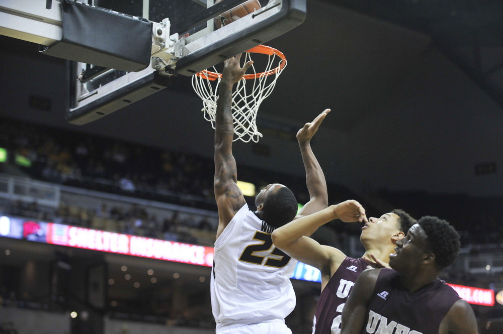 Missouri's Russell Woods makes a basket as Maryland-Eastern Shore's Dontae Caldwell and Bakari Copeland watch on Sunday, November 15, 2015 at Mizzou Arena. Missouri won 73-55.