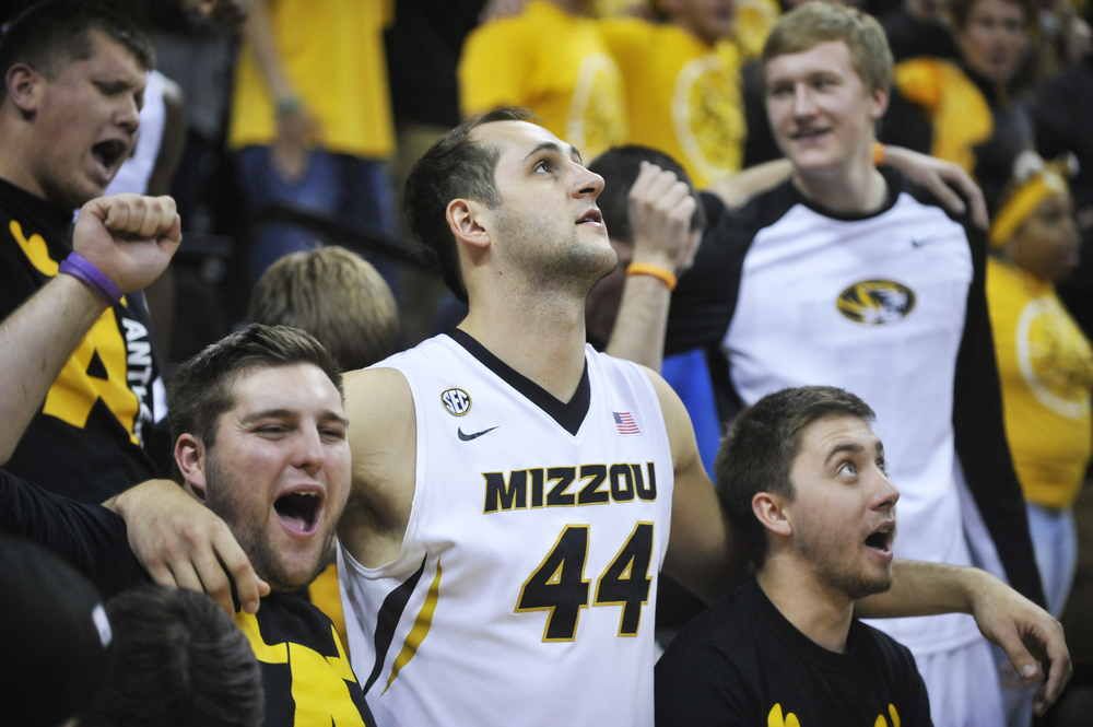 Missouri's Ryan Rosburg looks at the scoreboard as he drapes his arms around two members of the Antlers after their win against Maryland-Eastern Shore on Sunday, November 15, 2015 at Mizzou Arena.