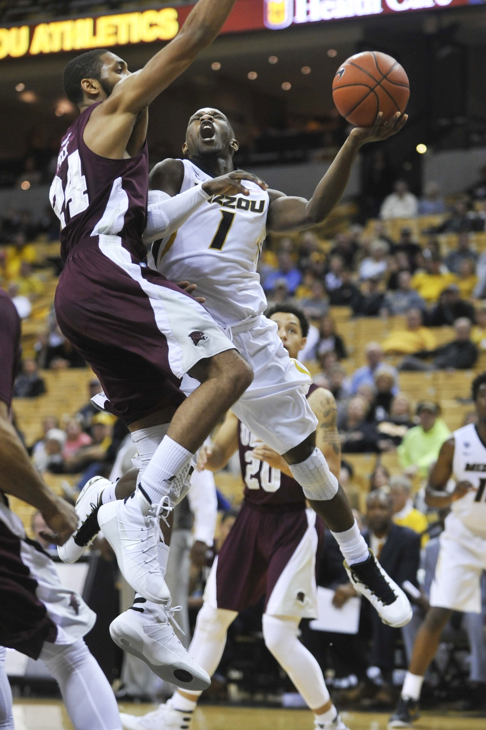 Missouri's Terrence Phillips shoots the ball as Maryland-Eastern Shore's Derrico Peck attempts to guard him on Sunday, November 15, 2015 at Mizzou Arena. Missouri won 73-55.