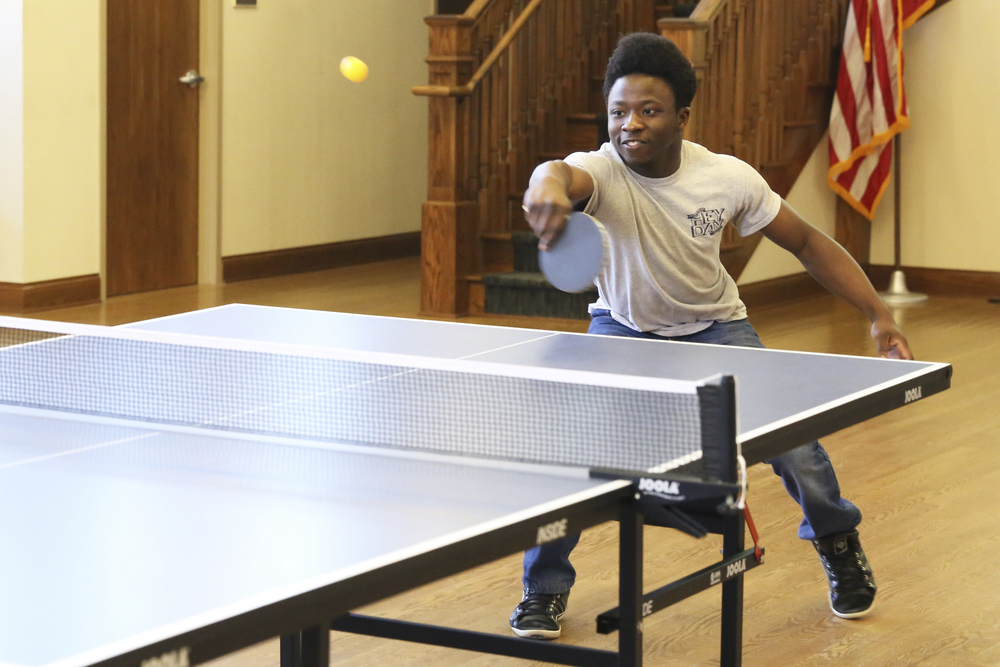 Rotshak Dakup plays ping pong with a fellow club member at Dorsey Gym on Columbia College's campus.