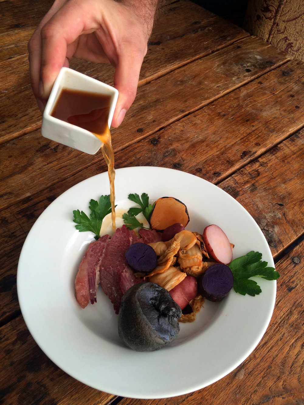 Corned Beef & Kimchi Potatoes Steamed in Kombu, Ramen Bone Broth, Squid Ink Yorkshire Pudding