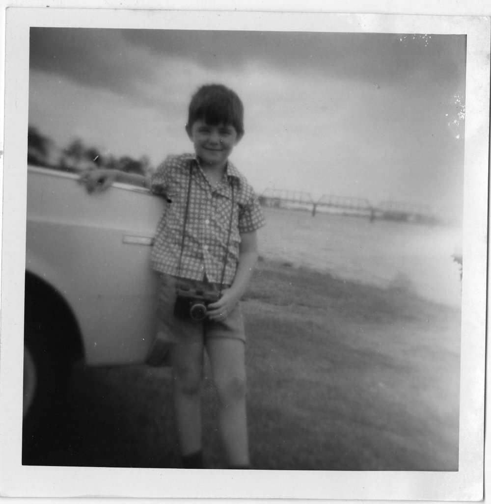 I've been interested in photography for quite a long time – check out this photo of me when I was quite young with a camera around my neck!