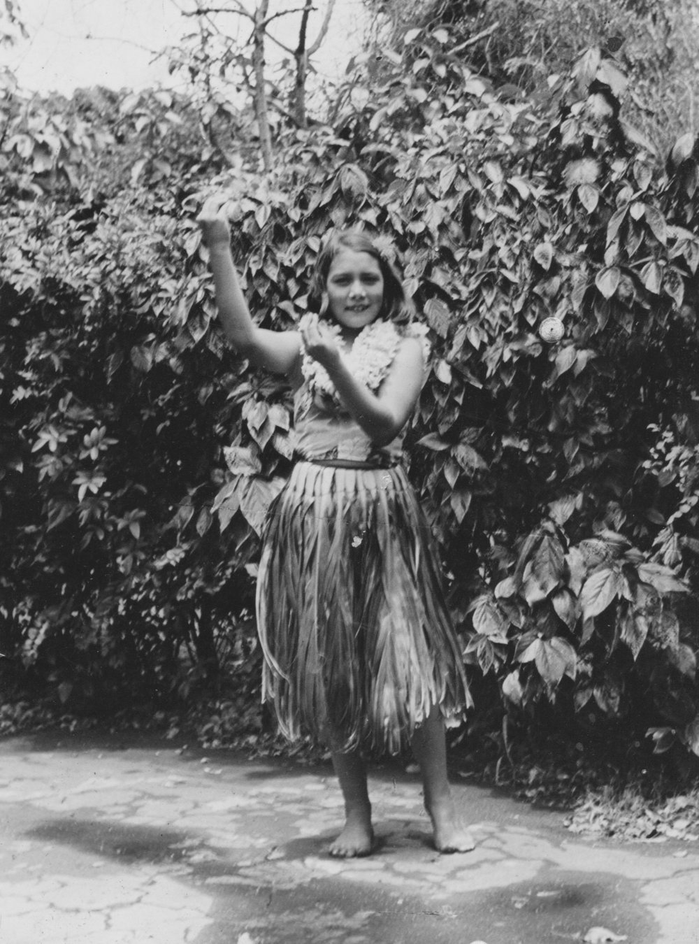 Lessons from My Mother - Not everyone has a picture of their Mother in a grass skirt. I think she's 12 in this photo.My Mother, Margaret Mildred Berge, was born in 1928, a half-breed Japanese-American from Honolulu, Hawaii – had an eighth grade education. Yet she could zip through the daily crossword like a Wellesley graduate, having expanded her vocabulary by looking up the words in an old black Funk and Wagnall's dictionary that was never far from the kitchen table where she sat in the mornings, dressed in a well-worn, blue and white cotton kimono.For most of my life she was the only woman I knew who survived a bombing, having been 12 or 13 at the Japanese attack on Pearl Harbor on December 7th, 1941.She was quite beautiful, dark eyed, raven-black hair, high cheek-bones and breasts coveted by every man who knew her. She was a great dancer, a voracious reader and a quick study with intelligence far beyond her formal education. She was a factory worker for most of her life. Starting at a Dynacolor plant in Brockport, NY where she spent 8-hour days mostly in the dark packing film canisters, I think. Then to the Owens-Illinois glass plant where she and dozens of other local women got jobs and worked on the line. When they figured out they were being paid for less than the men doing the same job, they took their grievances to management.