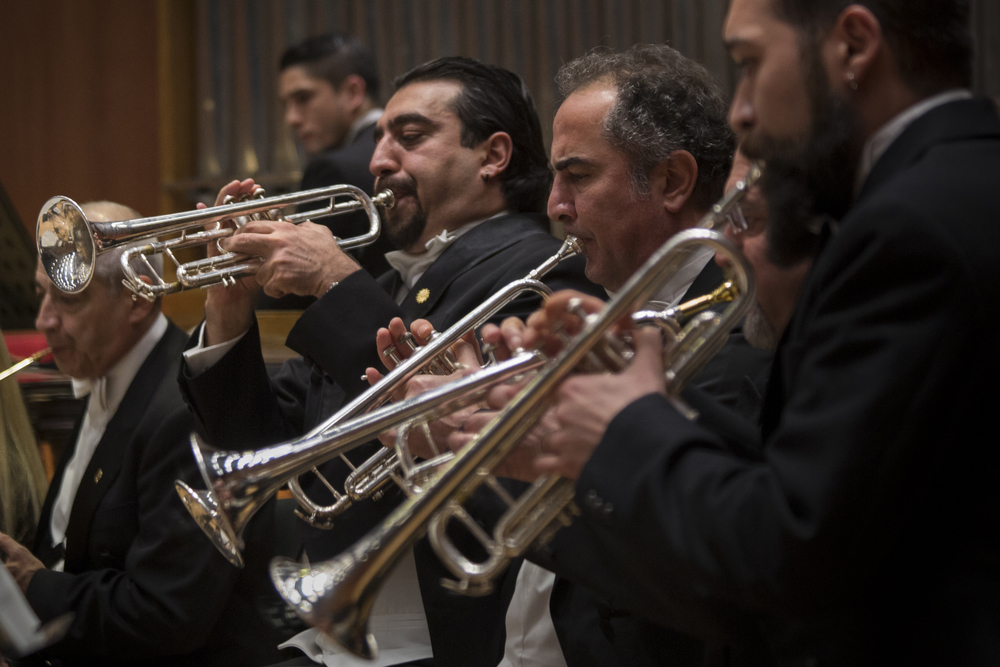 Cem a musician member of the CSO's administrative team and fellow trumpeters perform during a weekly concert. Many of the CSO musicians have multiple jobs for financial reasons. Ankara, 18th of December 2014.