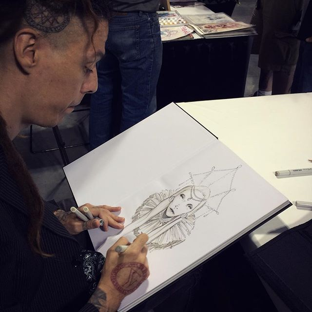 Here's @davidstoupakis doing a sketch in someone's TOME 2 at NYCC.