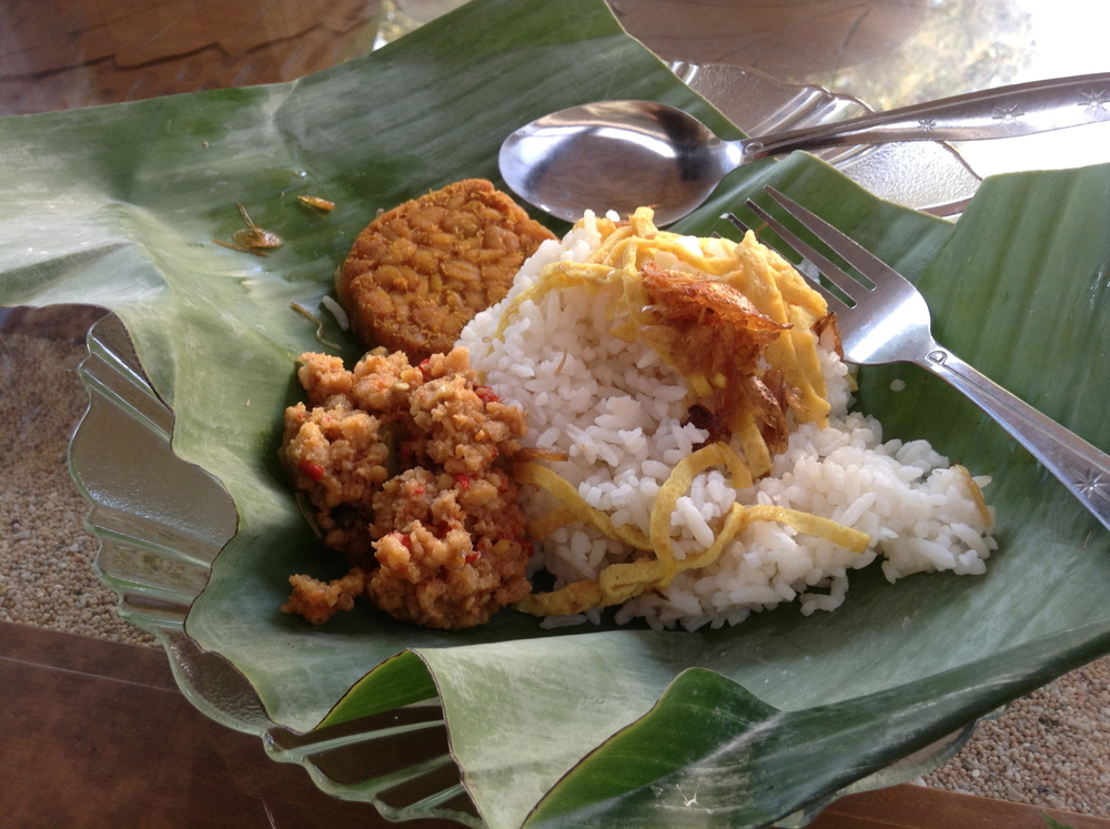 Nasi uduk for breakfast: coconut rice, omelette, bean curd paste and fried tempeh.