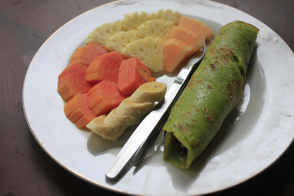 Balinese pandan pancakes with palm sugar and coconut.