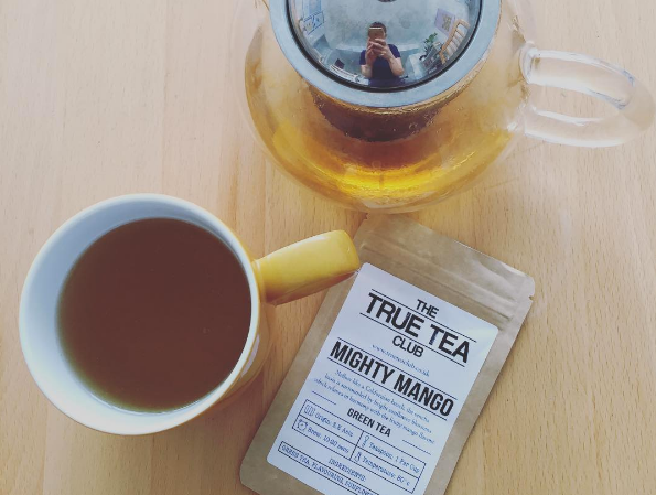 Mighty Mango tea...plus an accidental 'teapot selfie'. It's a thing.