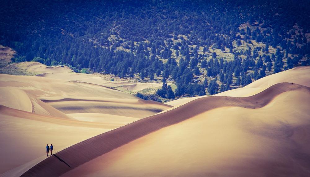 A Couple Walks Along A Dune Ridge - NPS Photo
