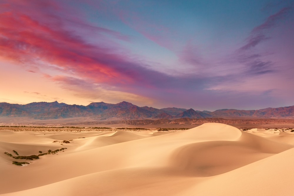 The setting sun sets the sky ablaze during a summer sunset on Mesquite Sand Dunes in Death Valley National Park. -  (PHOTO: JARED ROPELATO/SHUTTERSTOCK)