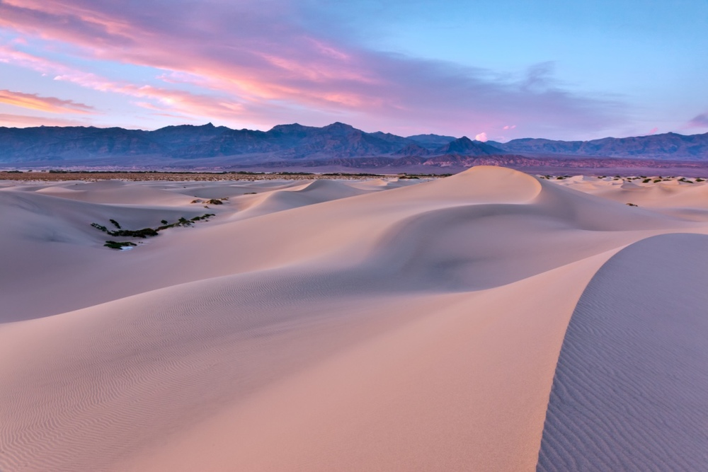The Mesquite Dunes in Death Valley National Park are a constantly changing phenomenon and the dunes pick up the color of a sunset beautifully - ( PHOTO: JARED ROPELATO/SHUTTERSTOCK)