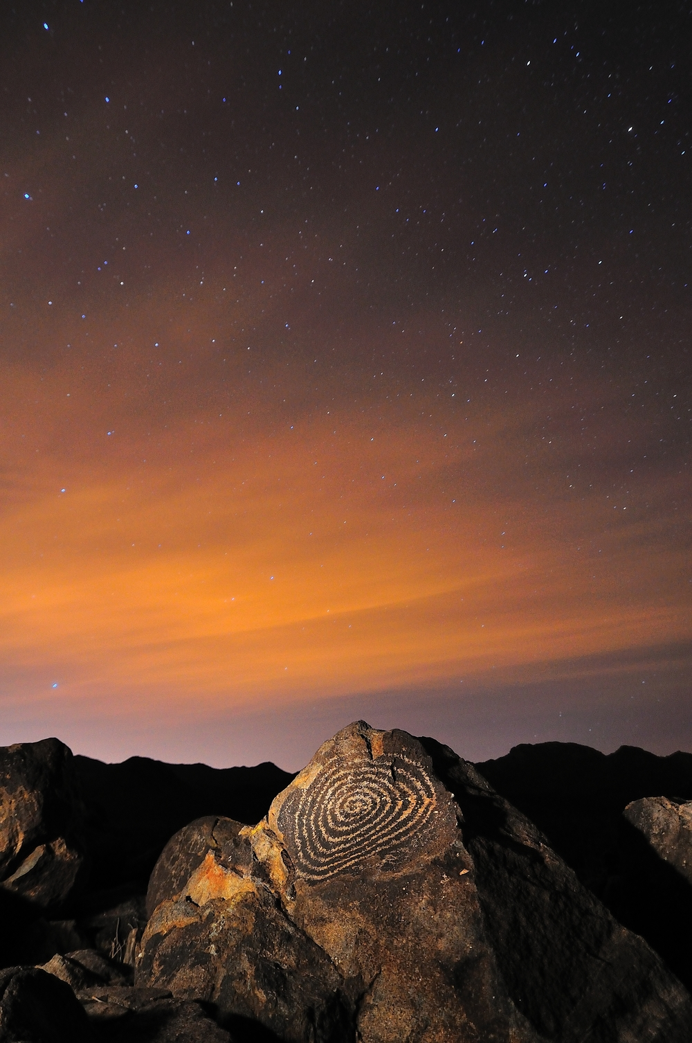 STARS OVER SIGNAL HILL PETROGLYPH - (PHOTO: RCole3/SHUTTERSTOCK)